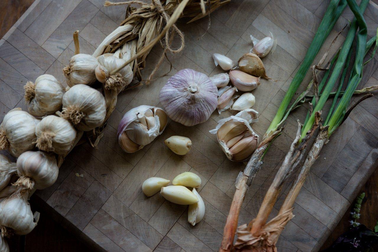 Garlic bulbs on a wooden board