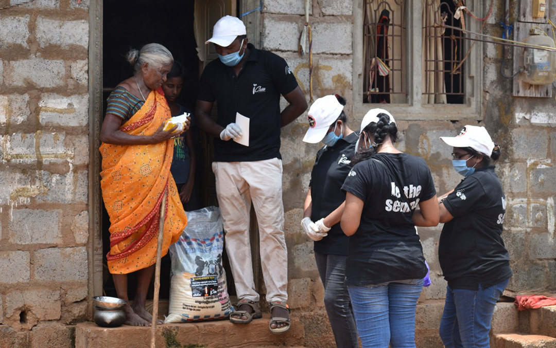 People in line for Covid relief in India. Image from ADRA