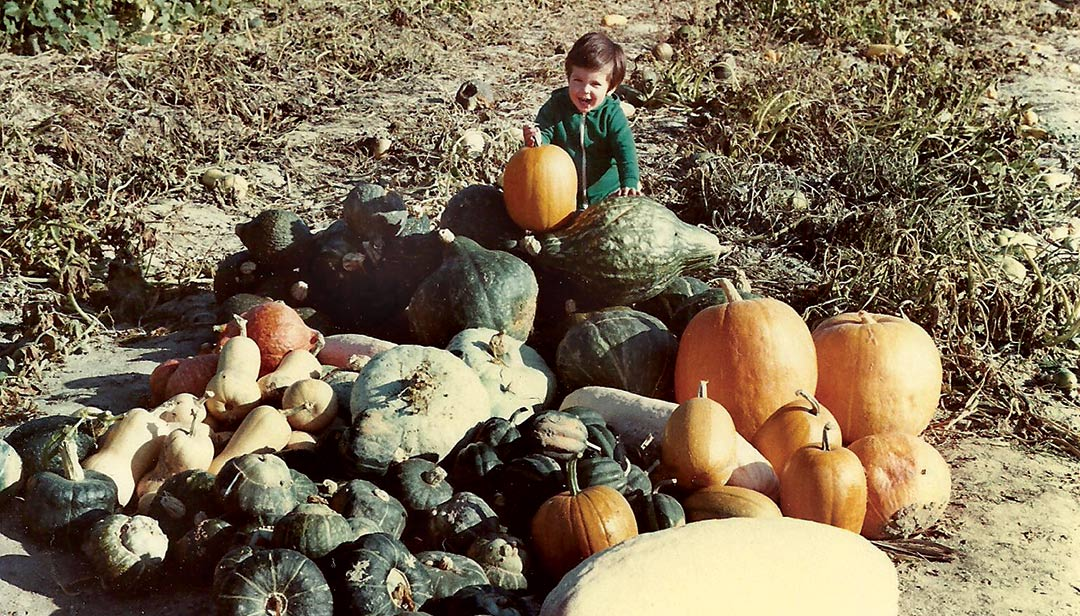 A young Jere Gettle enjoys a squash harvest!